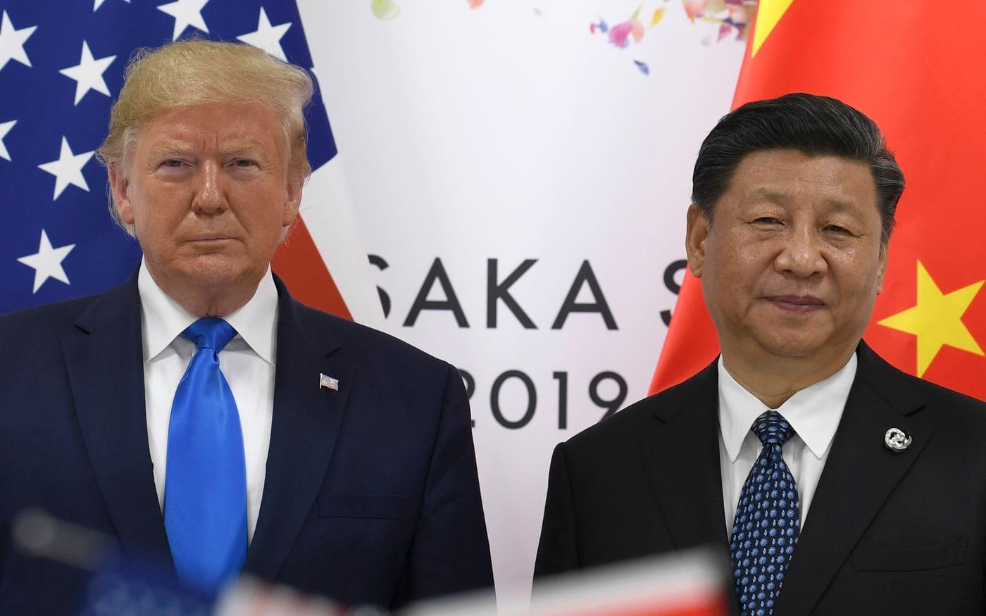 Donald Trump com presidente chinês Xi Jinping durante o G20. Foto: Times