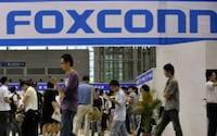 Funcionários da Foxconn que produzem o iPhone 5 entram em greve